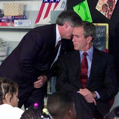 The 50 Most Powerful Pictures In American History President Bush's Chief of Staff Andy Card whispers into the ear of the president to give him word of the plane crashes into the World Trade Center, during a visit to the Emma E. Booker Elementary School in 11 September 2001, Moslem, Rare Historical Photos, Powerful Pictures, Iconic Photos, Rare Photos, Rare Images, Famous Photos, Rare Pictures