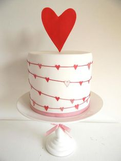 cute Valentine cake, I think it be super cute to exchange the hearts for lady bugs or shamrocks too.