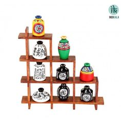 Set of Nine multi coloured handpainted warli pots, artistically placed on a Sheesham wooden frame. This will add color and vibrancy to your decor. Can also be installed on walls. An exquisite home decor product.  Buy now at - http://www.indikala.com/featured-products/ladder-stand-with-9-pots.html #Ladder #Pots