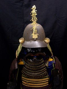 This Suit of Armor is for Momoyama (1573 to 1615) fighting priests. The Maedate on the helmet repeats the chant of Namu Myoho Renge Kyo, and there are Buddhist Beads slung over the Dou (chest). The helmet is very old and has crossed feathers for a mon on its Fukugaeshi The arms (Kote) have great chain mail and a large robust plate design