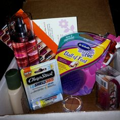 This sample box rocks! Influenster sent me: Sheer Cover concealed in light/medium, Sally Hansen Salon Effects Nail Polish Strips, Aveeno Daily Moisturizing Body Wash, 1 SoyJoy Strawberry Fruit Bar, Bath & BodyWorks Paris Amour Body Mist, Chapstick LipShield 365 tube, & Dr. Scholl's For Her Ball of Foot cushions!! I'll try everything, & let y'all know what I think!