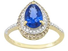 We would make a move on this ring ASAP because a design like this does not last long - beauty is of the essence! | 1.70ct Pear Shape Kyanite With .12ctw Champagne And .14ctw Round Diamond 14k Gold Ring