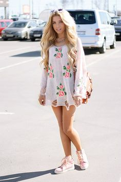 This outfit is a gorgeous outfit for spring time. This outfit is a cute short dress with a beautiful flower design printed on it.