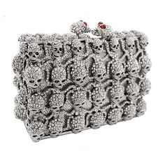 The sparkling multi skull couture hard clutch is perfect for bringing out your dark and mysterious side or for adding a quirky twist to any outfit.  Featuring Swarovski crystal, they come with a shoulder chain and the famous Butler & Wilson attitude.