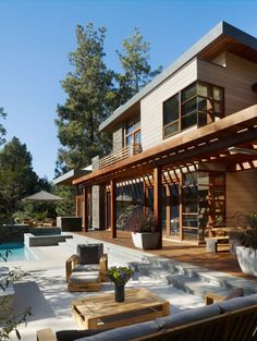 Irregularly Shaped House With a Small Grove of Eucalyptus and Pine Trees on the Site | Home Decorating Styles