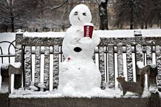 That's a frappucino please: a snowman complete with cigarette and coffee cup iin St James's Park  Peter Macdiarmid/Getty