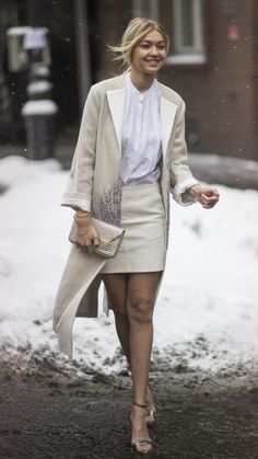 A white work wardrobe is perfect for autumn and winter. This long cream coat looks great paired with a mini skirt, white blouse, heels and sparkling clutch. See more street style ideas to inspire your office look at www.redonline.co.uk.