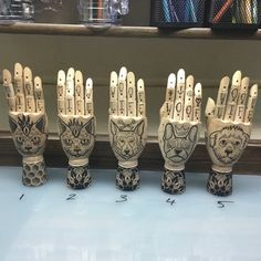 wooden hand mannequin with a dark blackwork dotwort tattoo style design geometric pattern bee hive cat dog french bulldog german shepherd all are hand drawn https://www.etsy.com/listing/263409246/dog-art-pet-love-mannequin-handfrench?ref=shop_home_active_6