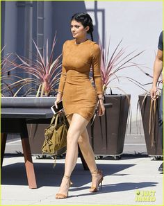 kylie jenner flaunts her curves in skin tight dress 01