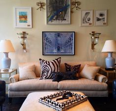 Neutral #sofa and #ottoman is spruced up with detailed printed #pillows and wall #art at #Dallas #Mecox.