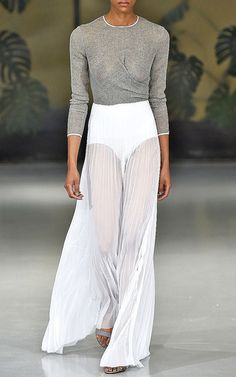 This long sleeve **Barbara Casasola** dress features a thin cotton top with draping at the bodice, and a high waisted skirt with pleating throughout.