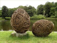 Giant branch egg sculptures for the garden. Nail them down so the don't end up in the pond on a windy day! I like the swirls.