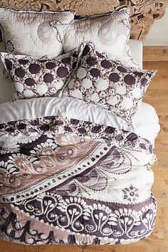 I love this Anthropologie Tahla Quilt, with its bold patterns with a nice white background.