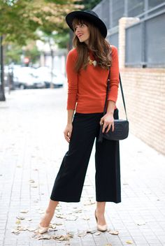 fall / winter - summer outfits - fall outfits - casual outfits - fall outfits - street style - street chic style - business casual - office wear - orange crew neck sweater + statement necklace + black culottes + nude stilettos + black fedora + black shoulder bag