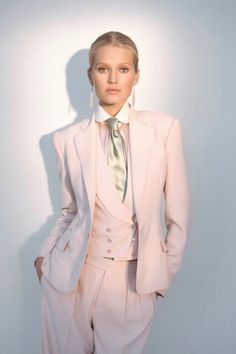 RL spring 2012. This is a rendition of the classic men's 3 piece suit (the Edwardian Male), but this lady does it well in a pink suit with double breasted vest and satin tie! <3 YUM
