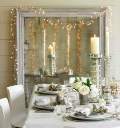 Porta candele alti e specchio con luci