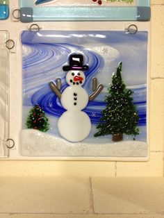 Fused glass snowman panel.