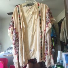 Fringed kimono Tan kimono with geometric designs. Not fp. Make an offer!! I could sell on ♏️erc for less! Free People Tops