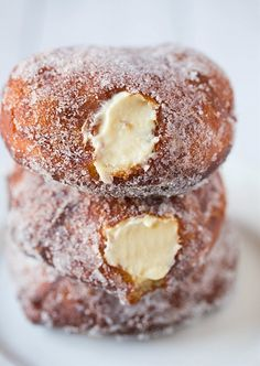 Oh good lord someone make these for me! Vanilla Cream-Filled Doughnuts
