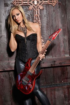 Nita Strauss - Alice Cooper: Mr Cooper can probably have anyone he wants on guitar. This girl can sling that 6-string.