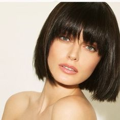 Short blunt bob with heavy front bangs. Very chic and modern. Chin length. Short hair. Hairstyle. Haircut. Brunette. Classic.