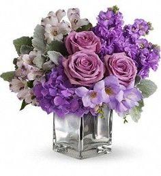 For Alicia (Pretty in Pink) Lavender roses, purple stocks, purple hydrangea, lavender alstromeria, and lavender freesia with some dusty miller -