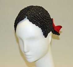 1950's, American. I love the hand worked straw braid made to look like a hair do. It has a red velvet bow on the back.