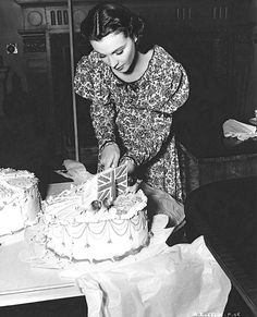 "Here she is on the set of ""That Hamilton Woman,"" cutting into her birthday cake (with a British flag), as she celebrates her 27th birthday."