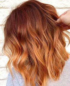 The ginger peach hair trend offers a more wearable way to rock bright colors. Scroll down to find out more about this hair color trend along with the prettiest examples of ginger peach hair. Ginger Hair Color, Red Hair Color, Ombre Ginger Hair, Pretty Hair Color, Ombre Hair, Peach Hair Colors, Pastel Colors, Bright Colors, Cheveux Oranges