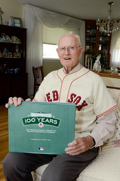 Former Red Sox pitcher Bill Monbouquette poses for a photo with the 100 year anniversary book of Fenway Park while inside his Medford home.    Read more: Medford's Bill Monbouquette celebrates golden anniversary of no-hitter - Medford, Massachusetts - Medford Transcript http://www.wickedlocal.com/medford/news/x246334832/Medfords-Bill-Monbouquette-celebrates-golden-anniversary-of-no-hitter#ixzz2926NUa3O