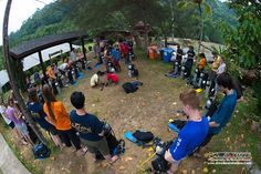The whole group pays attention to our PADI Instructors' demonstration of the equipment assembly conducted in the spacious field next to our Gaya Island beach house.