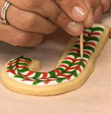 How to Decorate Marbleized Ornament and Candy Cane Cookies, Step 8 These beautiful holiday cookies seem complicated, but the technique is amazingly simple—and all you need is a toothpick to create the look. Christmas Sugar Cookies, Christmas Sweets, Holiday Cookies, Christmas Candy, Holiday Treats, Christmas Tree, Christmas Cupcakes, Holiday Desserts, Candy Cane Cookies