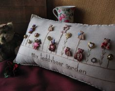This winter-themed hand-made muslin needlework pillow is perfect for winter decor and fans of snow and the cold! Size is approximately 14 1/2 x 8.