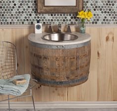 Reclaimed oak wine barrel is disassembled and modifed before repurposing as a bath vanity or wetbar. Finished with multiple custom-blended waxes, hand-rubbed into the oak. Plumbing access from underside.