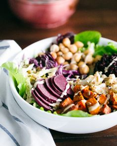 Roasted Nourish Bowl with Lemon Tahini Dressing | A Couple Cooks. Protein: Chickpeas, sunflower seeds. Great directions on how to put together your own nourish bowl!