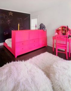 Drawers to section off the bed area, love the pink and sheepskin too