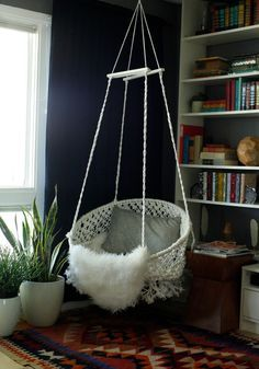 made using macramé knots tied with a clothes line, a hula hoop and a metal frame from a bungee chair