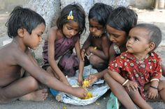 Indian slum dwelling children share a meal donated by well-wishers at a roadside in Amritsar in 2009. Pneumonia and diarrhea are among the top causes of childhood deaths around the world, particularly among the poor, said a report out Friday by the UN Children's Fund.