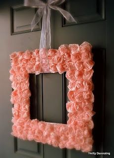 This square wreath is made out of tissue paper, not fabric, which give a beautiful soft elegant look. You could even do this with a picture framed and put you and your husband's wedding photo in it.
