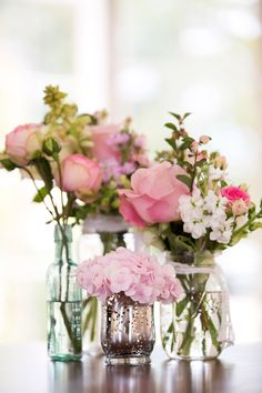 Pink, roses, peonies & hydrangea stems in glass jars - Image by Lily and Frank Photography - Lace Claire Pettibone Gown & Jimmy Choo Shoes for a Bright Pink & Turquoise Wedding with Grey Groomsmen & Chocolate Naked Cake.