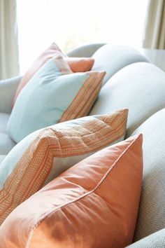 Custom pillows feature Samuel and Sons Agra Cord with Tape and Agra Linear Border applied to both the front and back. Seen on the House of Turquoise, design by Anne Hepfer Designs.