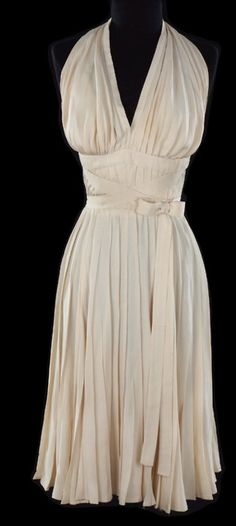 "Costume designed by Travilla for Marilyn Monroe in ""The Seven Year Itch"" (1955).  Yes, it's that dress!  From PROFILES IN HISTORY"