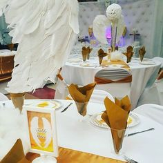 Heavenly repass. Angel wing centerpieces. White and Gold. Mini dessert table.