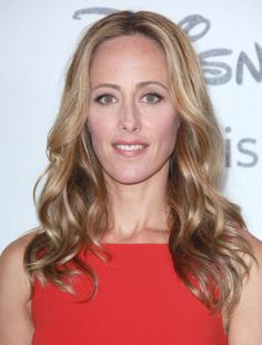 Kim Ravers long, blonde hairstyle