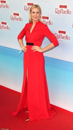 Show-stopper: Actress Kelly Rutherford looked fabulous in a floor-length scarlet gown with...