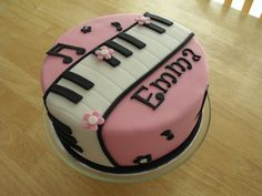 A pink, flowery piano cake for a girl named Emma! via Cake Central | #music #theme #dessert