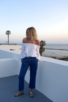Tuck the Tibi Satin Poplin Off-The-Shoulder Tunic into denim for a chic update on a classic outfit combination. As seen on Lucy Williams of Fashion Me Meow.