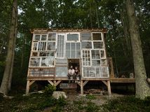 The Glass-Walled Cabin That Romance Built This is an AMAZING story of  a young couple and their dream to build a house with reclaimed windows..Watch the video
