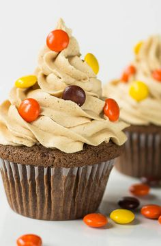 Double Reese's Cupcakes with a peanut butter cup hidden on the bottom. (uses boxed cake mix)