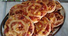 Jeder von uns kennt die Zimt-Schnecken. Wie wäre es mit einer herzhaften Variante? Die Pizza-Schnecken sind eine super Wahl für eine Party anstelle von klassischen Häppchen.